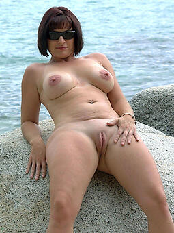 perfect naked matured in the first place beach photo